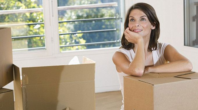 Woman packing to move home