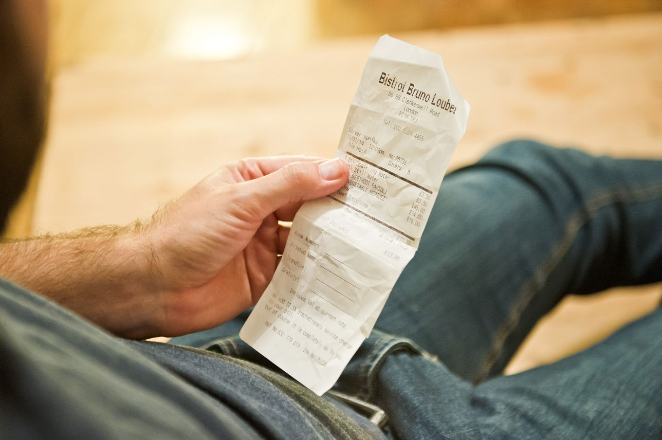 Man holding receipt