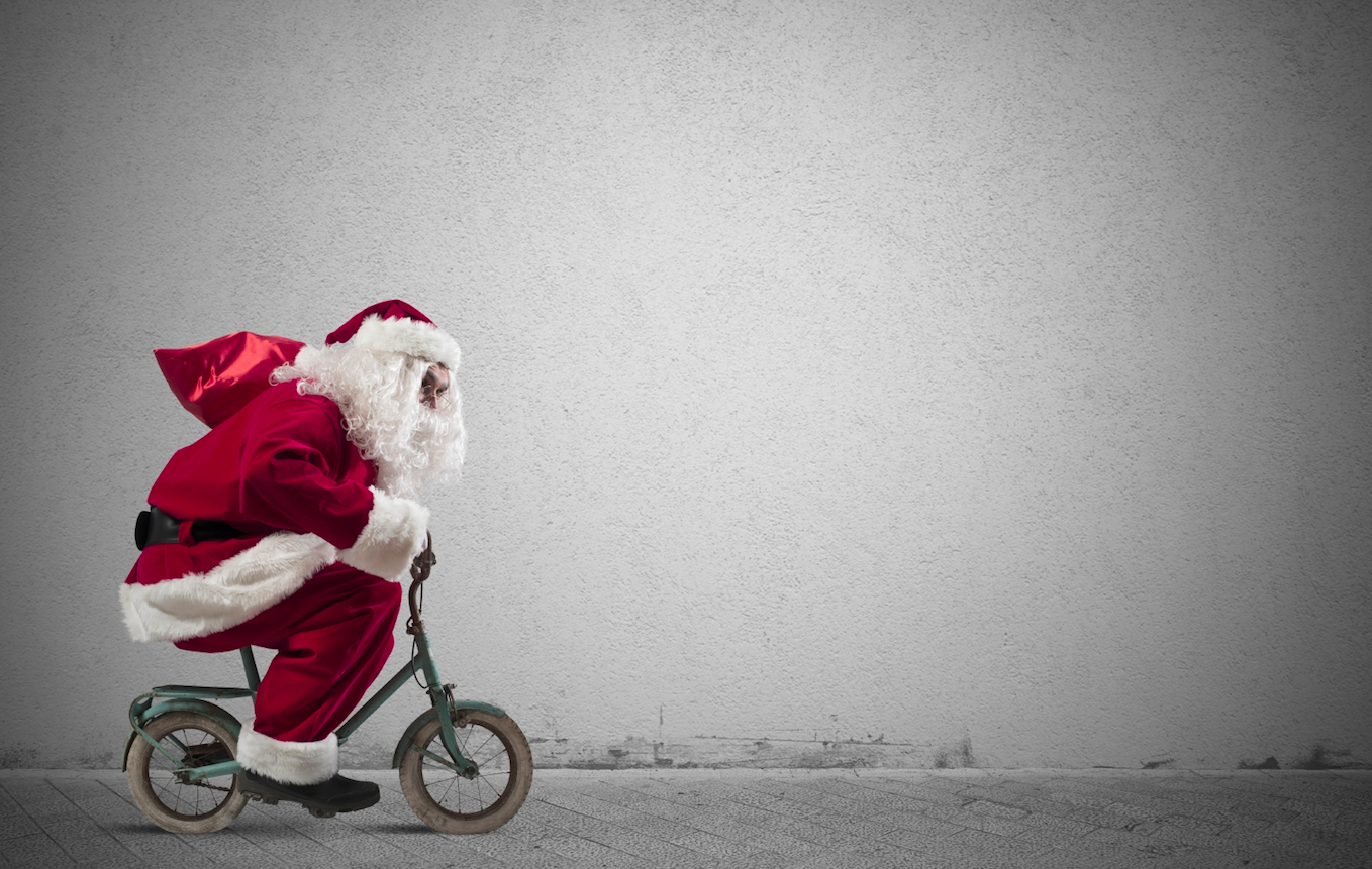 Father Christmas on a bike