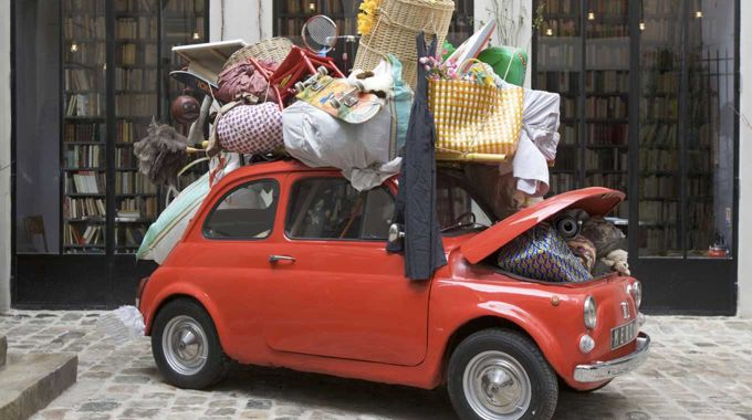 Student car overloaded with storage while moving