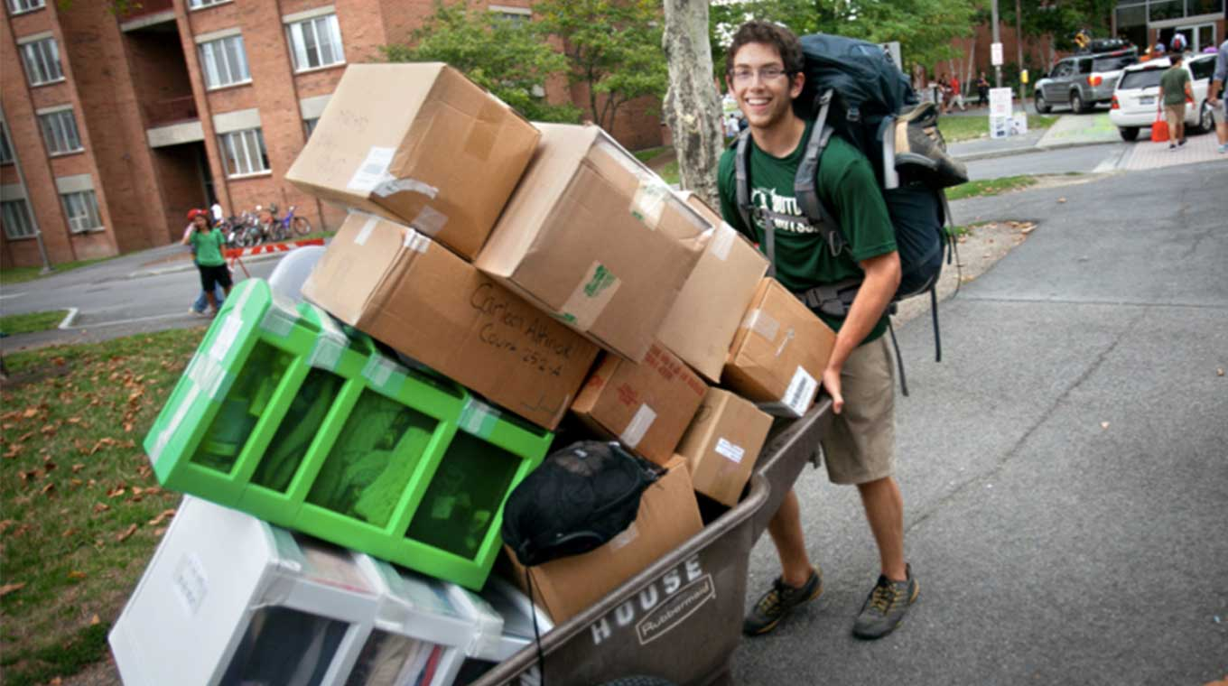 Student moving with boxes