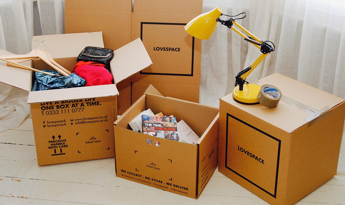 LOVESPACE storage boxes being used for packing