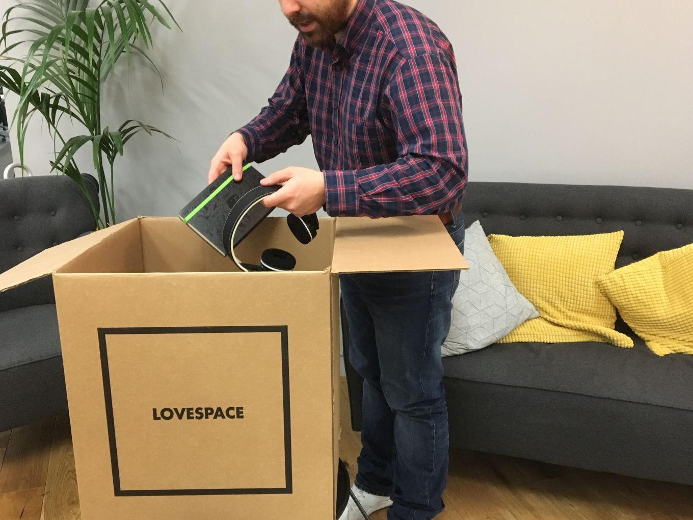 Hipster beard packing into boxes